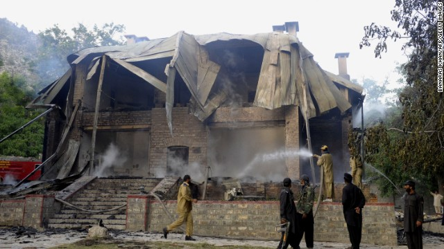 Pakistani firefighters extinguish a blaze which gutted a historical building in Ziarat, southeast of Quetta, on June 15, 2013