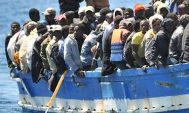 Migrants arriving at Lampedusa (Source: The Guardian)