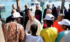 Pope Francis meeting migrants at Lampedusa (Source: The Guardian)