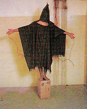 "US forces torturing a ""terrorist"" at Abu Ghraib in Iraq"