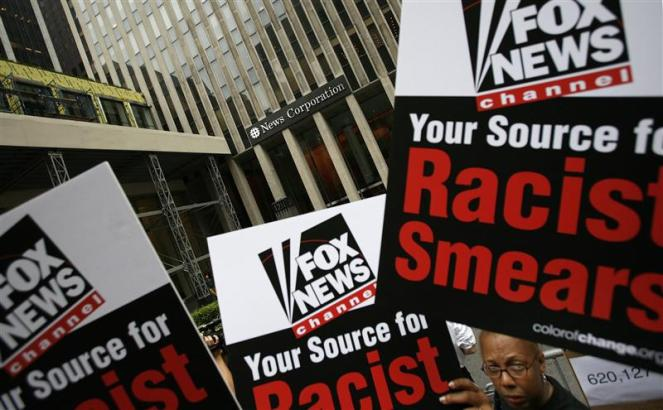 Members of Color of Change protest against Fox News Channel outside the News Corporation building in New York