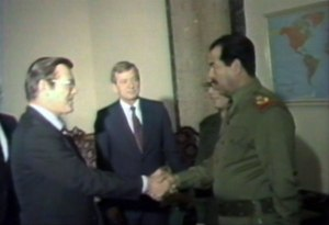 Donald Rumsfeld and Saddam Hussein exchange greetings
